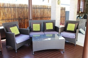 RATTAN OUTDOOR LOUNGE SETTING WITH GLASS TOP COFFEE TABLE