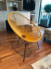 Yellow designer Acapulco egg chair