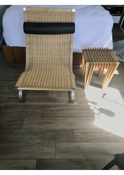Cane,  steel and leather chair of modern Scandinavian design